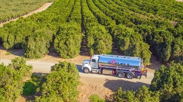 Fuel Delivery Truck In Field